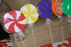 CANDY LAND PARTY: Giant Lollipops- Styrofoam painted in different designs, sprinkled with glitter, wrapped in cellophane and then a dowel rod is stuck in them.