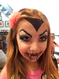 Halloween make up face paint of a Vampire girl by Athena Zhe