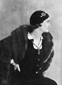 Coco Chanel poses for illustrator and designer Paul Iribe, her lover in the 1930s. Iribe made her the model for Marianne, the iconic symbol of French liberty. Note the bold jewelry that Chanel favored; she was ahead of her time in many ways. Photo from Chanel and Her World by Edmonde Charles-Roux.