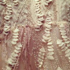 Close up detail on Monique Lhuillier's 'Candy' gown in blush.