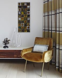 I just love velvet upholstery on armchairs!   Mid-century decor - Tribeca Triplex by Amy Lau Design