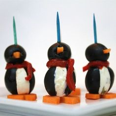 "Cream Cheese Penguins I ""Stuffed olives with cream cheese has always been a favorite of mine but I would never have thought to shape them like a penguin. CUTE!"""