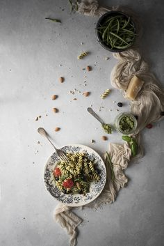 Fusilli with green bean and almond pesto, tomatoes and olives
