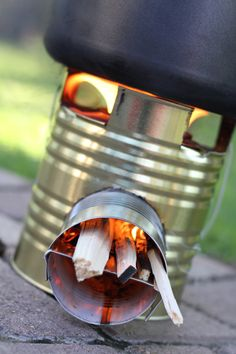 to Build a Rocket Stove and Impress the Boys ;) Build a Rocket Stove- One of the best and most efficient ways to cook in an emergency!Build a Rocket Stove- One of the best and most efficient ways to cook in an emergency! Diy Camping, Camping Stove, Camping Survival, Outdoor Survival, Survival Prepping, Survival Skills, Camping Hacks, Outdoor Camping, Survival Shelter