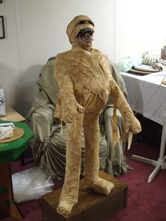 Halloween prop. Paper mache and wrapped in old sheet, then stained with instant coffee