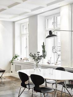 minimal white - wood floor - coffered ceiling