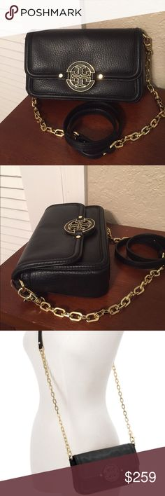 """🆕Tory Burch """"Amanda"""" Cross-Body bag. NWT This adorable Tory Burch Cross-Body shoulder bag in black pebbled leather is the perfect petite bag to use every day. Inside has 3 card slot pockets and logo jacquard lining. There is plenty of room for your essentials and the Crossbody strap is removable to become a clutch. On the front has the signature Tory Burch Double-T medallion with hidden snap closure. Also for sale in royal tan color. Approximate measurements: 8"""" L x 5"""" H x 2"""" D with a 21…"""