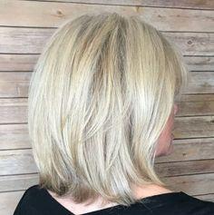 60+ Medium Layered Ash Blonde Hairstyle