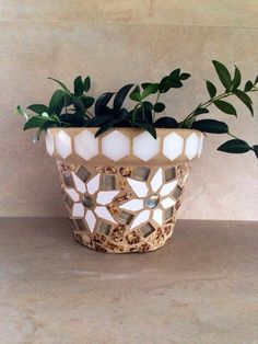 A personal favorite from my Etsy shop https://www.etsy.com/listing/246895960/mosaic-flower-pot-terracotta-planter