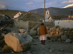 www.villsethnoatlas.wordpress.com (Ajmarowie, Aymara) Aymara Indian Woman Walks Through her Village in the Chilean Andes