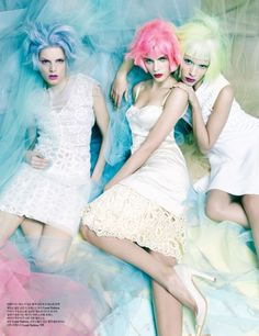 W Korea celebrates 7 years with 7 top models wearing spring colored wigs and frocks.
