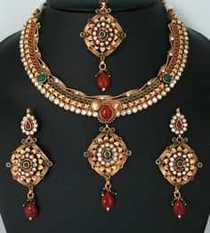 Exclusive Indian Polki fashion Jewellery Set with Ruby Red,Emerald,White stones with Maang tikka-011PLKJ55  http://www.craftandjewel.com/servlet/the-1720/imitation-jewelry-online/Detail