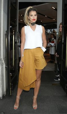 Fashionista: Vogue Williams was pushing the sartorial boundaries when she attended the Lady Garden Campaign launch at the TopShop store at Oxford Circus on Thursday