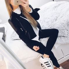 Adidas shoes and black and white casual outfit