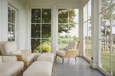 Love the simple lines of these french window panels used as a patio enclosure
