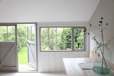 View Onto The Garden - A Beautiful Home Tour Of A Traditional British Summerhouse In London Painted In Little Greene's French Grey And Farrow & Ball's Off Black   Photos By Light Locations
