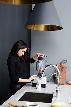 Meghan Markle looks great in every pic I've seen, including this very monochromatic minimalist kitchen!