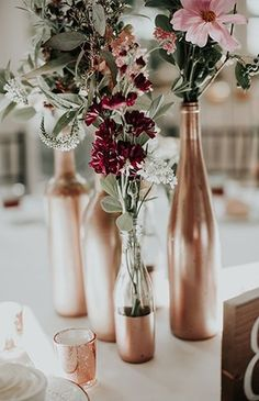 Moody Mauve Wedding with Copper Details - Inspired By This Copper Wedding Inspiration Wine Bottle Centerpieces, Wedding Wine Bottles, Wedding Table Centerpieces, Flower Centerpieces, Centerpiece Ideas, Reception Decorations, Wine Bottle Decorations, Fall Wine Bottles, Backyard Decorations