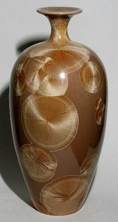 Crystalline glazed pottery by John Mankameyer. I started making crystalline glazed porcelain pottery in 1975. I am completely self taught.I fire all my work to cone 10-12. I fire all work in a manual controled kiln, I prefer to have a more hands on experience.