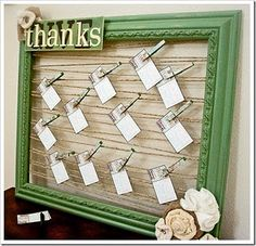 Frame with lines of twine, decorated clothes pins for attaching photos, notes, etc.