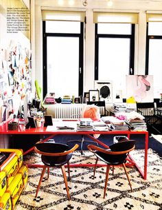 industrial red desk + gorgeous moroccan rug + inspiration board + retro wood chairs + yellow trunks=