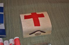 First aid kits made with Wolf Scouts. Got these pre made small boxes for $1 at Michaels and the kids cut out first aid crosses to decorate and filled with essentials. Fun and portable.