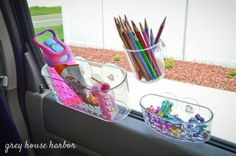 """DIY Cars Hacks : Illustration Description How about a shower basket to store your kid's """"essentials?"""" Winning Car Hacks for Moms on Frugal Coupon Living. -Read More – Road Trip With Kids, Family Road Trips, Travel With Kids, Toddler Travel, Family Vacations, Family Travel, Life Hacks, Diy Car Trash Can, Road Trip Activities"""