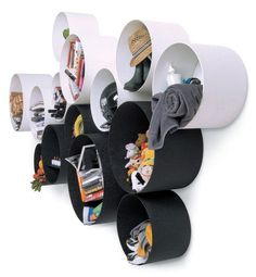 Handy storage for children's rooms - could be made using large cardboard tubes like those found in rolls of material or carpet.