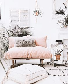 Couldn't you just kick back and relax in this gorgeous boho styled room with pastel pink, indoor plants and soft neutral accessories.