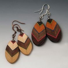 One of a kind wood earrings featuring the natural colors of the wood, by artist Martha Collins.