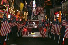 Flags follow the 9/11 Memorial Fire Engine during a unannounced ceremony in Times Square for the 10th anniversary of the attack. - Photo by Amy Laurel Hegy @A Tale of Two Tramps