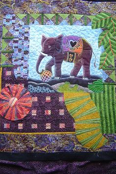 I am in looooove with the elephant on this!!