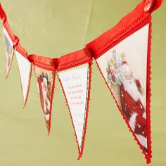 Up-cycling Christmas cards to make a festive banner, ornaments, and more.