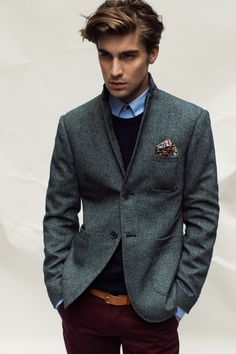 Gray wool blazer, cranberry slacks, blue shirt and black sweater. The belt is a nice pop of color. Perfectly styled.