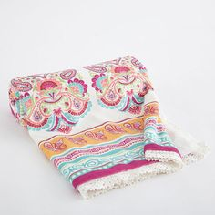 The Taj Mahal Blanket has a bright n' colorful palette featuring a trail of elephants printed on a soft velour fabric with a faux fur back and lace trimmed edge. Perfect for stroller rides, bundling or simply a boho accent to the nursery.