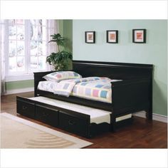 a guest bed i mind in my house coaster traditional style black finish daybed with trundle twin size daybed trundle included solid hardwoods