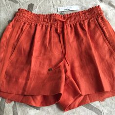 JCREW linen shorts Pretty and comfy JCREW shorts. 100% linen with 2 front & back pockets. Elastic waist with tasseled drawstring. Beautiful burnt orange color. New with tags!! J. Crew Shorts Cargos