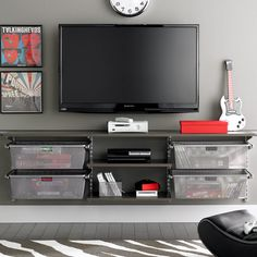 This shelving system in front room would work.  (Could mount slightly higher so could put x benches underneath)