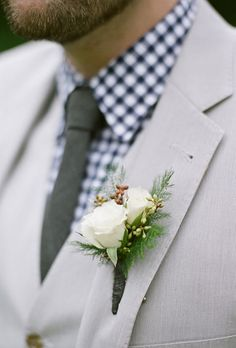 Rustic White Rose Wedding Boutonniere Jon wore J.Crew from nearly head-to-toe, sporting a tan suit and gingham-checkered shirt. He accessorized with a white, rustic-style boutonniere