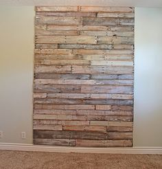 Room-height headboard made from pallets! Inspiration for possibly my own pallet headboard creation.