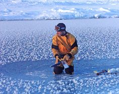 Jeff Bowman collects samples from frost flowers in the central Arctic Ocean.