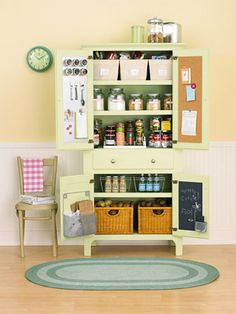 Vintage freestanding pantry already scored high in the storage department. Adding cool baskets and attaching corkboard, blackboard, and metal sheets to the inside doors makes this piece an ultimate storage solution. #pantry #kitchen