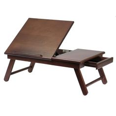 Use this Foldable Walnut Lap Desk at home to bring a loved one breakfast in bed or to work from home in your recliner or on the couch. This lap desk features a sturdy solid wood construction with a walnut finish. In addition This lap desk has a side drawer and book ledge.Foldable Walnut Lap Desk FeaturesSolid w
