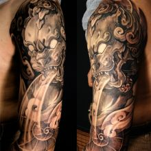 Half sleeve foo dog tattoo