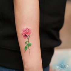 subtle tiny rose on an arm