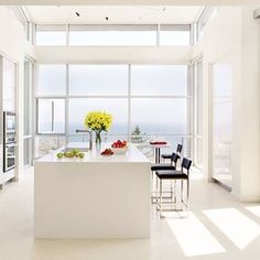 The kitchen of a Ketch Harbour, Nova Scotia, home by Alexander Gorlin Architects has floor-to-ceiling windows that provide a panoramic ocean view.