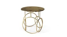 Side Table Kiki by Koket The KIKI side table evokes the romantic and seductive beauty of Parisian cabaret life. The revealing frilled undergarments, the surprise high kicks, hoops in a circle accompanied by blinding splendor give this table a sassy new spin on design. Gold furniture, modern side table, 2015 furniture trends, elle decor furniture