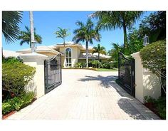 This gated N. Pinecrest estate sits on a beautifully landscaped lot. 7 bedrooms/7.5 Baths. Listing price: $2,675,000