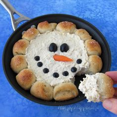 Warm up with winter with a skillet full of hot chicken dip surrounded by hot rolls. Scoop up the dip with the bread and enjoy. See the tutorial at Hungry Happenings.