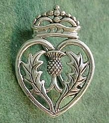 The luckenbooth brooch is a traditional Scottish love token: often given as a betrothal or wedding brooch. It might be worn by a nursing mother as a charm to help her milk flow, and/or be pinned to a baby's clothing to protect it from harm. Scottish Thistle, Scottish Highlands, Memento Mori, Tartan, At Least, Bling, Metal, Country Weddings, Vintage Weddings